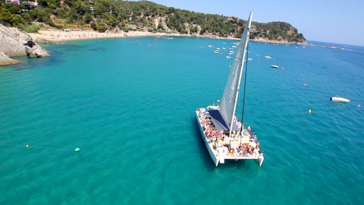 Party Boat in Costa Brava, North of Barcelona. Enjoy the blue water and jump from the boat for a refreshing swim during the hot summer of Barcelona